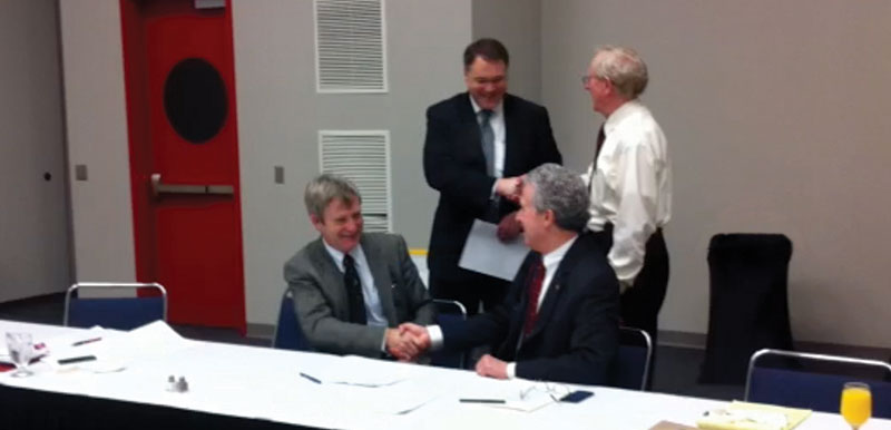 "Partners: AAPG and SEG officials signed the papers to become joint publishers of a new journal called ""Interpretation."" Participating were (seated, left to right) SEG President David J. Monk and AAPG President Ted Beaumont, and (standing, left to right) AAPG Executive Director David Curtiss and SEG Executive Director Steven Davis."