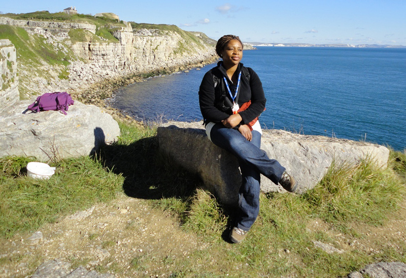 Clara at a Portland outcrop that shows good succession including the Portland Cherty series, the Portland freestone (quarry stone) and base of Purbeck Formation, Wessex Basin, Dorset, England