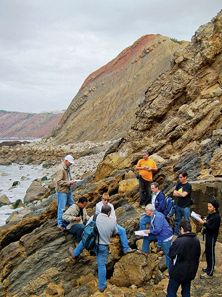 Geoscientists studying coastal and deltaic Oxfordian marls and sandy clays, 80 kilometers north of Lisbon. These prograding siliciclastics underline the intense subsidence and infill related to the Late Jurassic rifting at the Lusitanian Basin, coeval with the conjugated Jeanne D'Arc Basin.