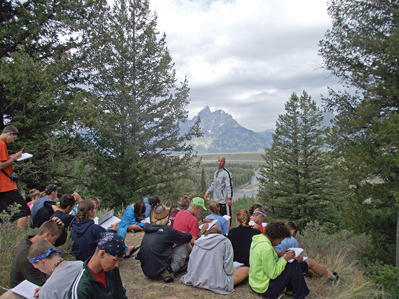 Bolhuis teaching his three-week long summer field course in geology and biology last July. Wyoming's Grand Tetons are in the background. Photo courtesy of Chris Bolhuis