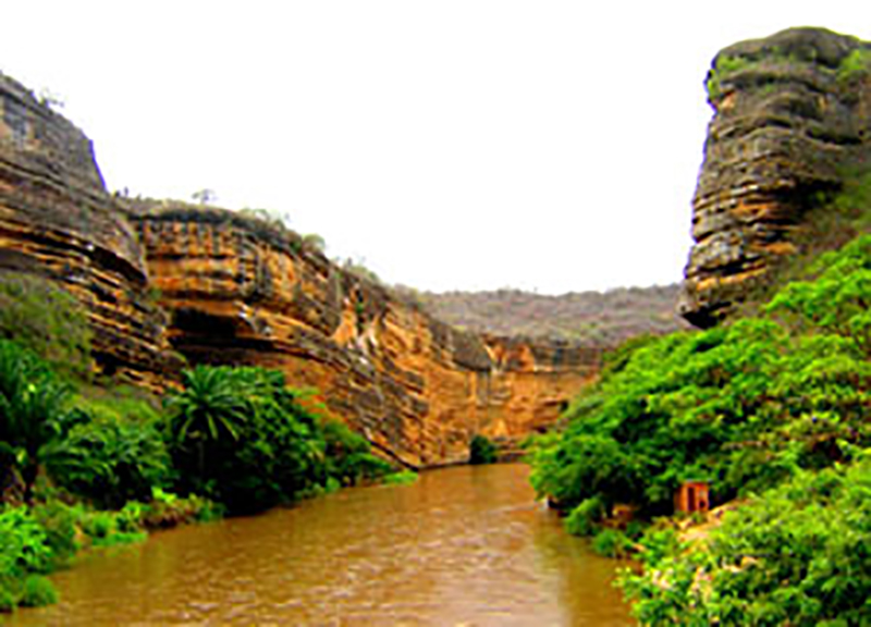 Cubal River gorge, south of Sumbe, Angola exposing Upper Cretaceous carbonates of the Kwanza Basin. These carbonates correlate to the Pinda Formation limestones and dolomites which have produced over 1.5 billion barrels of oil in shoal deposits in the shallow water areas of the Lower Congo Basin. Photo courtesy of Tako Koning