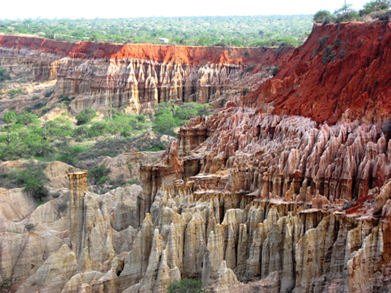 Miradoura da Lua, near Luanda, Angola, where shallow marine Tertiary (Miocene) aged sediments of the Kwanza Basin outcrop. These sediments are stratigraphically equivalent to the Miocene and Oligocene turbidite channels that currently are producing about 1.5 million barrels of oil per day in the deepwater Lower Congo Basin. Photo courtesy of Tako Koning