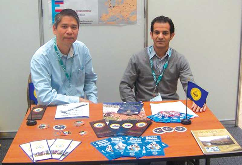 Herman Darman (left) and Anwar Al-Beaiji at the AAPG booth in Bucharest, R