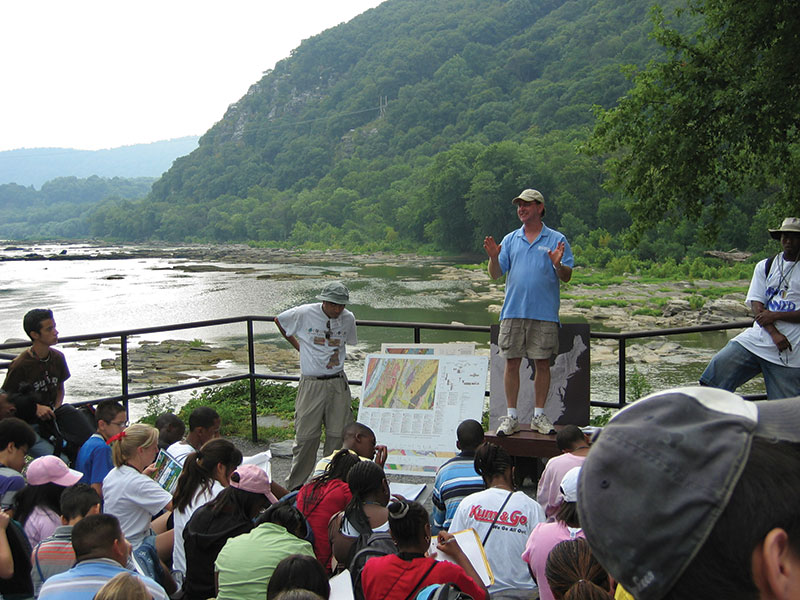 U.S. Geological Survey geologists give ninth grade GeoFORCE students a lesson on the geology at Harpers Ferry, West Virginia.