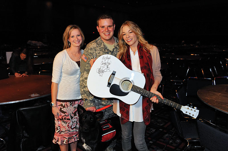 NAPE says thank you to an American Hero: Sgt. Michael Ryan, with his wife, Cary (left), and country music artist LeAnn Rimes.