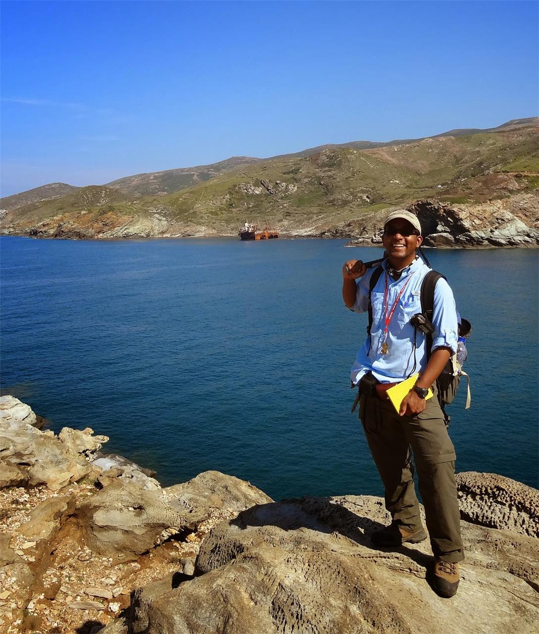 Tim Shin doing field research for his MS thesis at the Livada Detachment of retrogressed blueschists in the metamorphic core complex of Andros Island, Greece (2012)