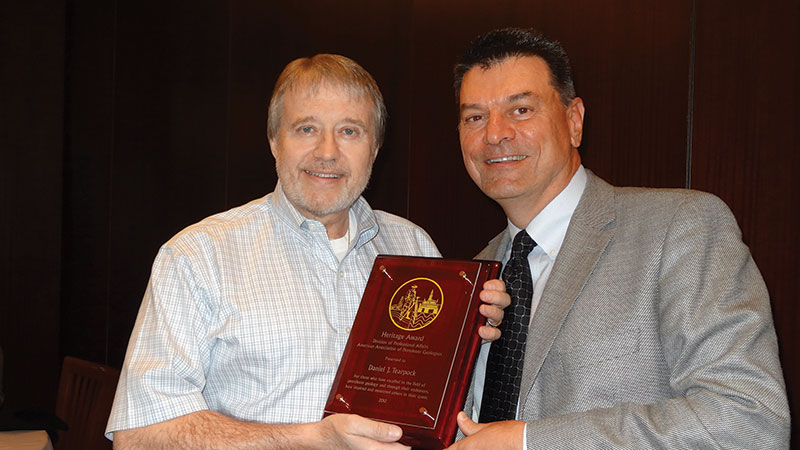 Daniel Tearpock, left, receives the DPA Heritage Award from division president Marty Hewitt.