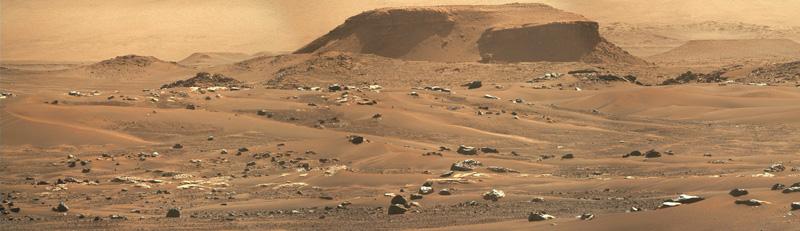 Panorama of dunes, boulders and distant Jezero Crater deltaic sentiments